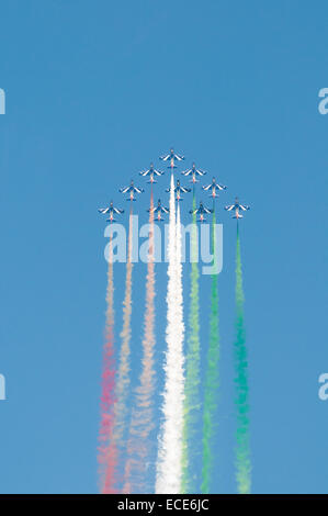 Italain Air Force aerobatic display team Frecce Tricolori flying in formation in a vertical climb - Stock Photo