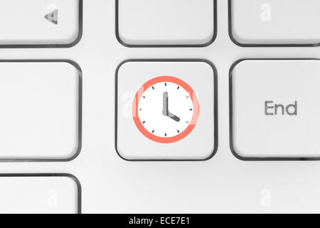Clock on the keyboard button - Stock Photo