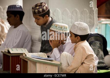 Mauritius, Port Louis, Jummah Mosque, Islamic education, children learning Koran in madrassa - Stock Photo