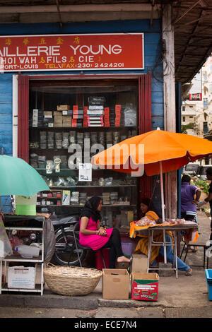 Mauritius, Port Louis, Chinatown, Rue Royale, Muslim women st at street stall - Stock Photo