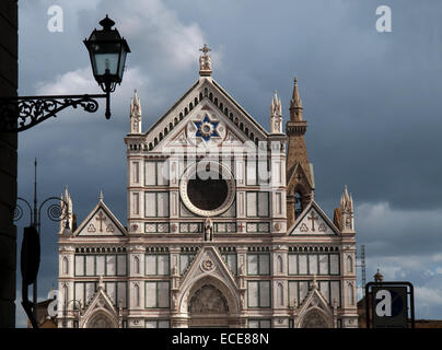 The Basilica di Santa Croce (Basilica of the Holy Cross) is situated against the  troubled sky. - Stock Photo