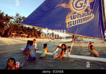 Boats to practice sailing. Children playing. White beach. Boracay. What a summer. Philippines. Boracay is a small - Stock Photo