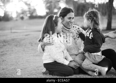 Argentina, Buenos Aires, Mother with two daughters - Stock Photo