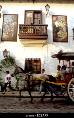 Kalesa ride, buggy horse carriage and large hotels in Malate. Facade of Barbara's Restaurant. Manila. Philippines. - Stock Photo