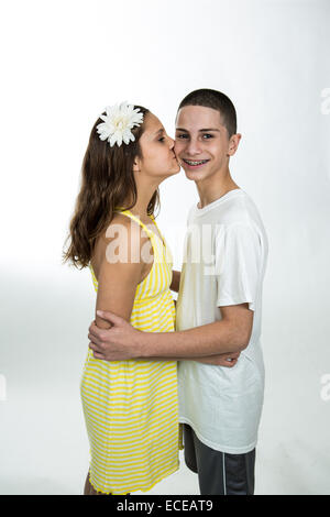 Portrait of a teenage girl kissing a teenage boy - Stock Photo