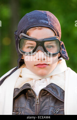 Portrait of boy dressed as a pilot - Stock Photo