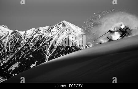 Austria, Front view of free ride skier downhill skiing - Stock Photo