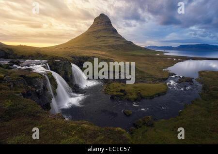 Iceland, Kirkjufellsfoss waterfall and Kirkjufell mountain - Stock Photo