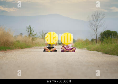 Two girls (6-7, 8-9) with balloons - Stock Photo