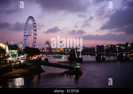 London UK from Waterloo Bridge at Christmas time, early evening, looking west towards the Palace of Westminster - Stock Photo