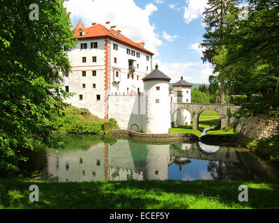 Sneznik castle near Cerknica intermittent lake, Slovenia.Snežnik Castle is a 13th-century castle located in the - Stock Photo