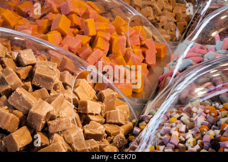 Varieties of Pick n Mix sweets on sale, covered in clear plastic domes Southport, Merseyside, UK - Stock Photo