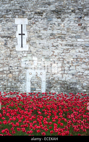 Ceramic poppies at the Blood Swept Lands and Seas of Red installation at the Tower of London England UK - Stock Photo