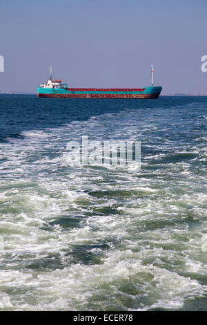 Cargo ship on the sea with waves foreground