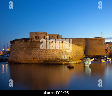 Angevin Castle of Gallipoli by night in Salento, Italy - Stock Photo