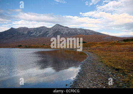 Beinn Eighe is a complex mountain massif in the Torridon area of the Highlands of Scotland. It forms a long ridge - Stock Photo