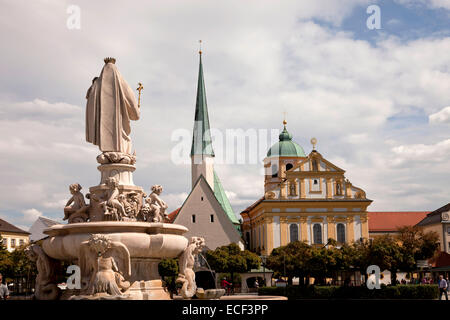 Church and statue of maria on Kapellplatz square in Altoetting, Upper-Bavaria, Bavaria, Germany, Europe - Stock Photo