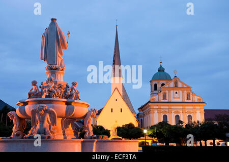 statue of Maria, church Magdalenakirche and the Chapel of Grace on Kapellplatz square in Altoetting at night,  Bavaria, - Stock Photo