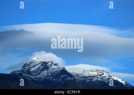 Clouds over the dormant volcano, Mount Cotacachi, in the Andes Mountains near Cotacachi, Ecuador - Stock Photo