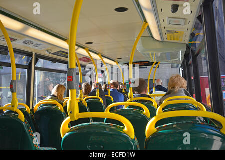 Interior back view of passengers seated on upper deck of London double decker bus England UK - Stock Photo