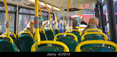 Passengers seated on top deck of a red London double decker bus England UK - Stock Photo