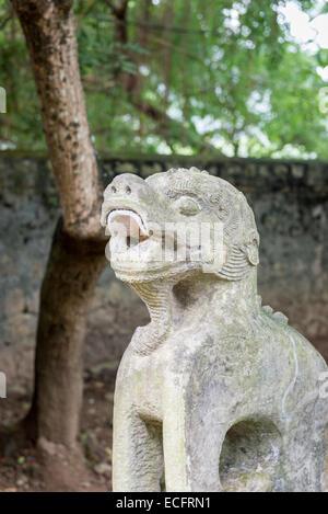 Lion statue detail at ancient capital city of Hua Lu, Nimh Binh Provence - Stock Photo