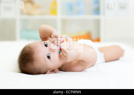 baby with teether toy - Stock Photo