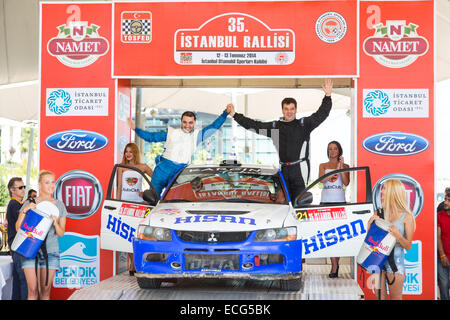 ISTANBUL, TURKEY - JULY 13, 2014: Hakan Kargin became ninth with Mitsubishi Evo 9 in 35. Istanbul Rally - Stock Photo