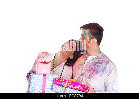 indian married couple Holi Festival gift - Stock Photo