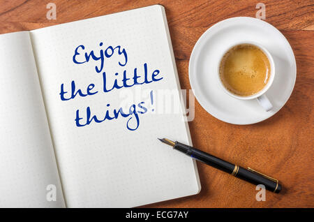 Notebook on a desk - Enjoy the little things - Stock Photo