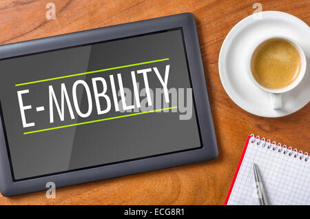 Tablet on a desk - E-Mobility - Stock Photo