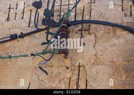 Maltese electricity power cables on a house in Malta - Stock Photo