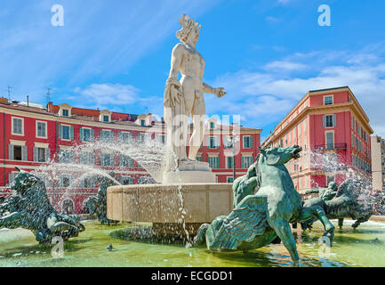 Famous Fontaine du Soleil (Fountain of the Sun) in Place Massena in Nice, France. - Stock Photo