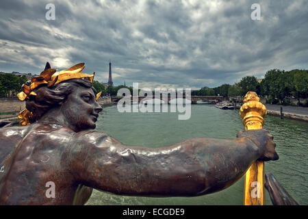 View of Seine River and Eiffel Tower from famous Alexander the III bridge in Paris, France. - Stock Photo