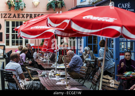 An outdoor cafe with sun umbrellas in Golden Cross Walk, Oxford, UK - Stock Photo