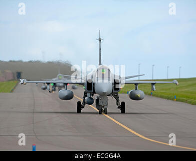 Line up of JAS 39 Saab Gripen single seat Mach 2 Fighter Jets taxiing to 05 at RAF Lossiemouth. SCO 9312. - Stock Photo