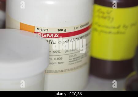 Bottled chemicals on laboratory shelves - Stock Photo
