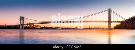 George Washington Bridge panorama above the New York skyline at sunset - Stock Photo