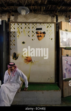 Qatari man wearing traditional thawbs garment also called Jalabiyyah siting in Souq Waqif market located in the - Stock Photo