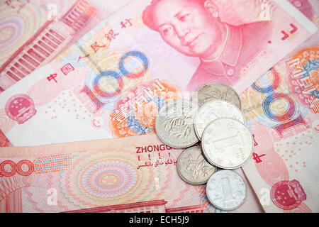 Chinese yuan renminbi banknotes and coins. Close up photo background - Stock Photo