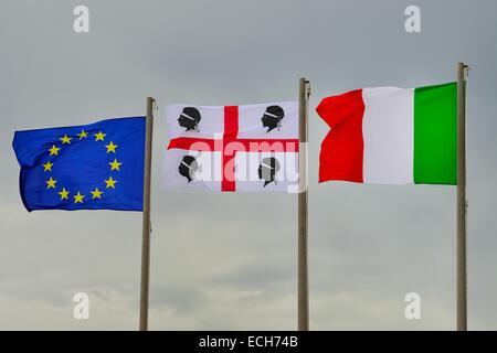 Three waving flags, European Union, Sardinia and Italy, Sardinia, Italy - Stock Photo