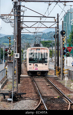 Kyoto, Japan. The Randen Tram Line connects the city to Arashiyama in the west. Part of the Keifuku Electric Railroad - Stock Photo