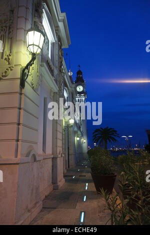 Exterior of the Port Authority of Valencia Building at dusk with it's clock tower - Stock Photo