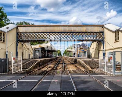 Strawberry Hill Railway Station with platforms, railway tracks and overhead pedestrian bridge in Twickenham, Greater - Stock Photo