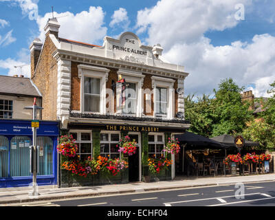 The Prince Albert - exterior of a typical traditional English pub with flower baskets in Summer, Twickenham, Greater - Stock Photo