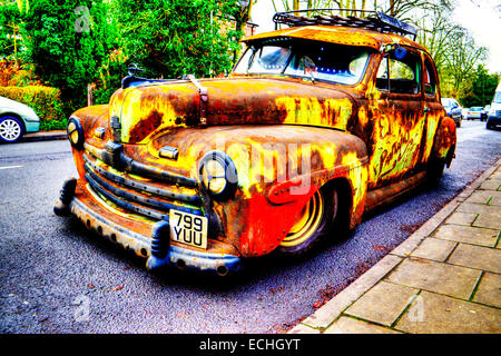 Ford super deluxe 8 V8 old  rusty car wreck 1947 classic parked rust rusted pitted unkempt unloved uncared for not - Stock Photo