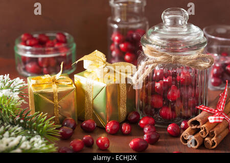 fresh cranberry in glass jars, winter decoration and gifts - Stock Photo