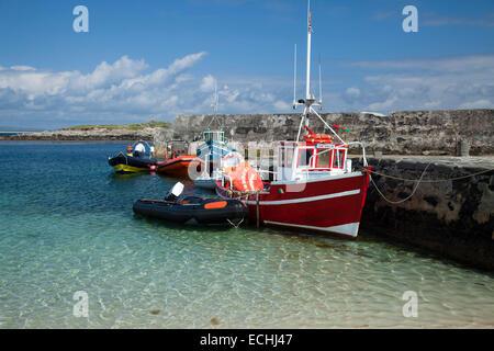 Fishing boats moored beside the pier on Inishkea South Island, County Mayo, Ireland. - Stock Photo