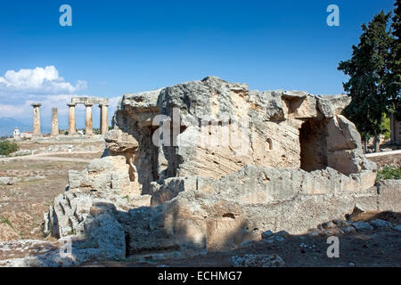 Fountain of Glauke, with the Temple of Apollo in the background among the ruins of Ancient Corinth, Peloponnese,Greece. - Stock Photo