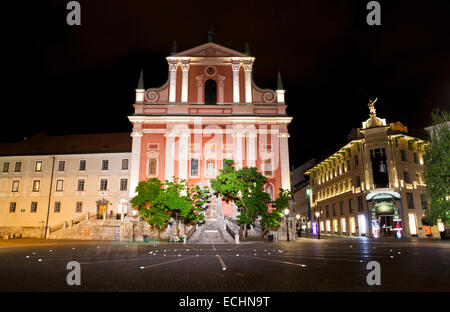 Ljubljana city at night, Slovenia. View to the Franciscan Church of the Annunciation on Preseren Square - Stock Photo